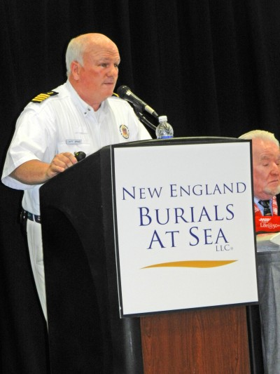 Captain Brad White speaks to a large audience at the AARP Boston Show