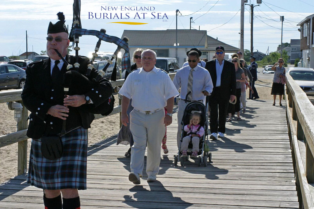 Bag Piper Leads Mourners To Boat for Burial At Sea